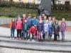 Przed pomnikiem Jana Pawła II
