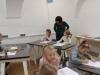 4.-nauczyciel-ogl¦ůda-prace.