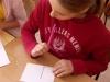 uczennica-wypisuje-kartk¦Ö-pocztow¦ů-1